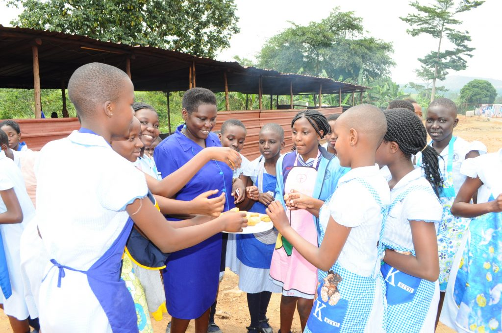 Pupils share cookies after baking lessons.