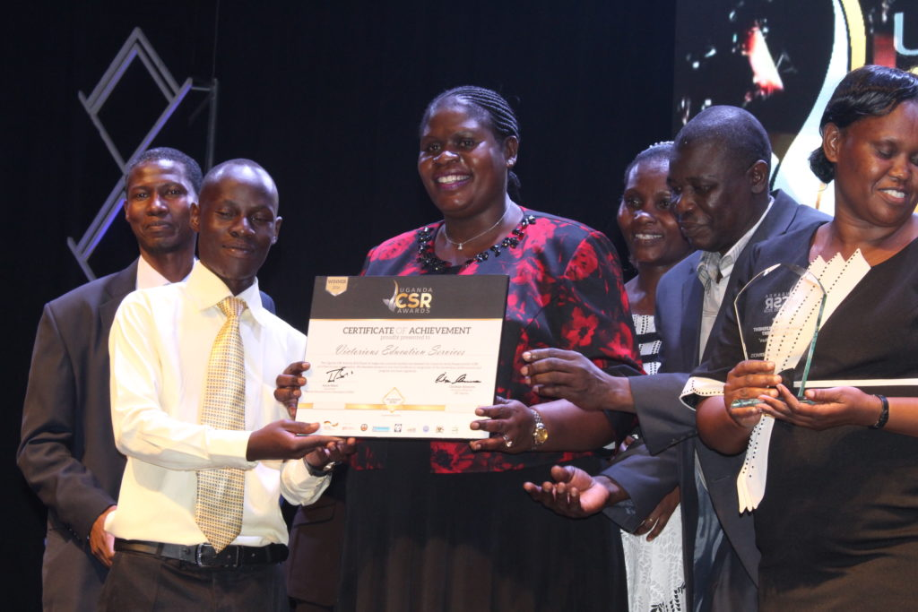 Dr. Barbara Ofwono Buyondo receiving Victorious Education Services' Uganda CSR Award 2016-Community Involvement and Development.-Education and culture category.